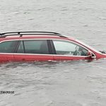Car submerged on the Holy Island Causeway