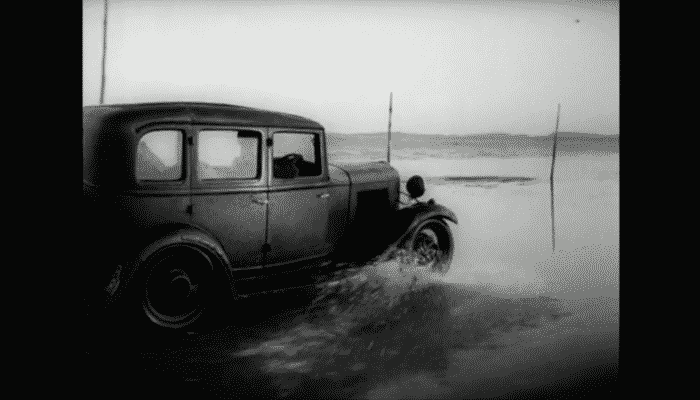 Post car drives across the sands to Holy Island